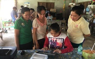 Donated PC, Printer and Reflecting Tapes to Khan Mak village in Vang Vieng